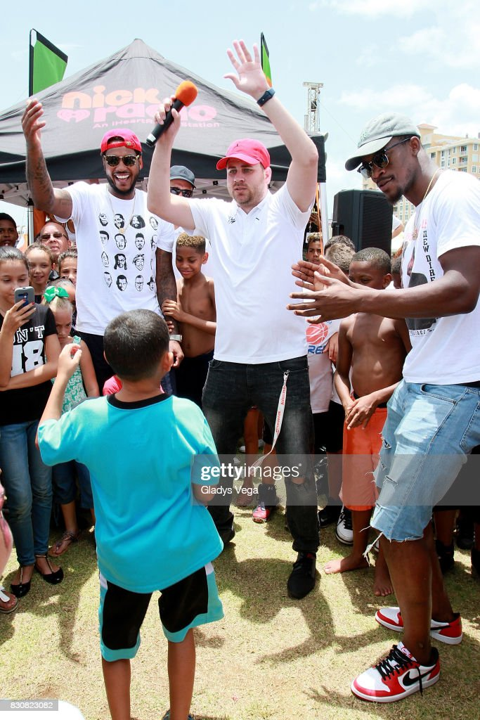 Carmelo Anthony, Danilo Beauchamp and Jimmy Butler participate with kids of Worldwide Day of Play at Bahia Urbana Bay Side Park on August 12, 2017 in San Juan, Puerto Rico.