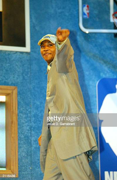 Carmelo Anthony from Syracuse acknowledges the fans as he is selected overall in the first round by the Denver Nuggets during the 2003 NBA Draft at...