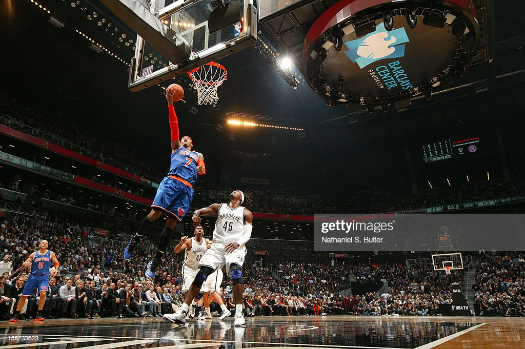 Carmelo Anthony #8 goes up for the easy basket on December 11, 2012 at the Barclays Center in the Brooklyn borough of New York City.