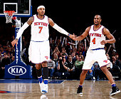 Carmelo Anthony high fives teammate Arron Afflalo of the New York Knicks during the game against the Atlanta Hawks on January 3 2016 at Madison...