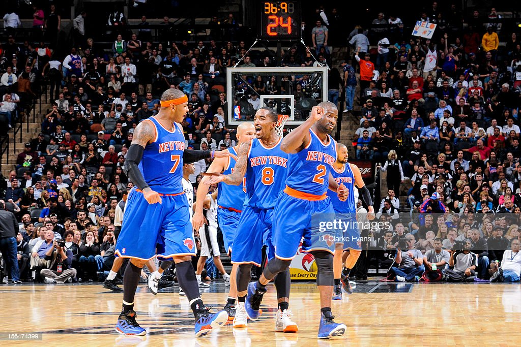 Carmelo Anthony #7, J.R. Smith #8 and Raymond Felton #2 of the New York Knicks celebrate in the fourth quarter against the San Antonio Spurs on November 15, 2012 at the AT&T Center in San Antonio, Texas.