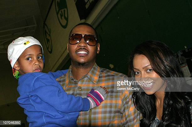 Carmelo Anthony Lala Vasquez and son attend the Get Schooled National Challenge and Tour on November 19 2010 in Denver Colorado