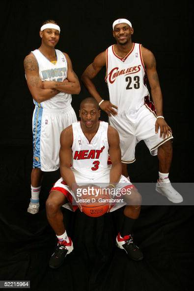Carmelo Anthony LeBron James and Dwyane Wade of the Sophomore Team pose for a portrait prior to the got milk Rookie Challenge during 2005 NBA AllStar...