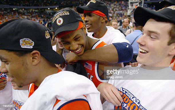 Carmelo Anthony of Syracuse celebrates with Hakim Warrick and other teammates after he and his team defeated Kansas 8178 during the championship game...