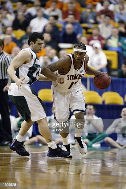 Carmelo Anthony of Syracuse dribbles against Justin Jackette of Manhattan during the NCAA Tournament on March 21 2003 at the Fleet Center in Boston...