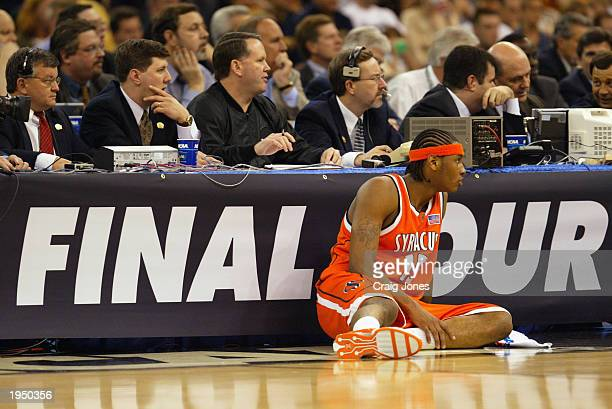 Carmelo Anthony of Syracuse eyes the action as he sits in front of the scorer's table before checking into the game against Kansas during the...