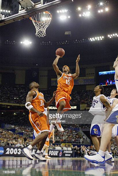 Carmelo Anthony of Syracuse shoots a jumpshot underneath the basket against the Kansas defense during the championship game of the NCAA Men's Final...