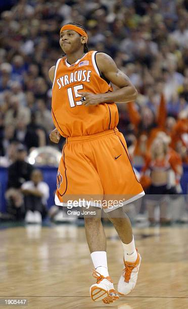 Carmelo Anthony of Syracuse smiles after making a basket against the Kansas defense during the championship game of the NCAA Men's Final Four...