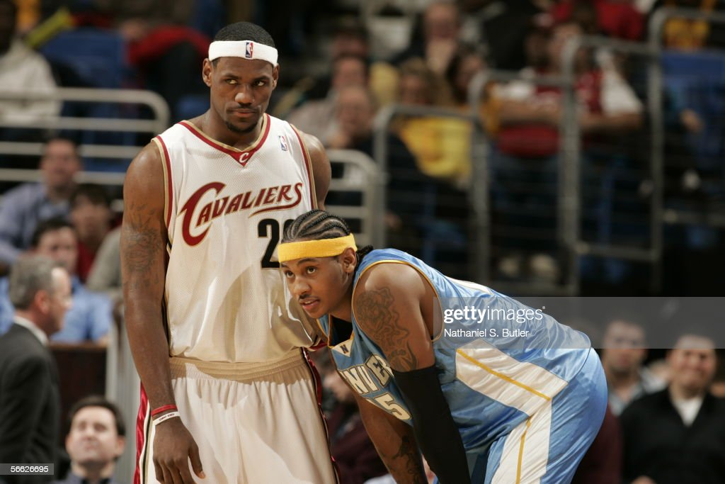 Carmelo Anthony #15 of the Denver Nuggets and LeBron James #23 of the Cleveland Cavaliers look on during the game on December 15, 2005 at the Quicken Loans Arena in Cleveland, Ohio.
