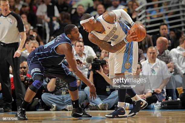 Carmelo Anthony of the Denver Nuggets as CJ Miles of the Utah Jazz defends in Game Five of the Western Conference Quarterfinals of the 2010 NBA...