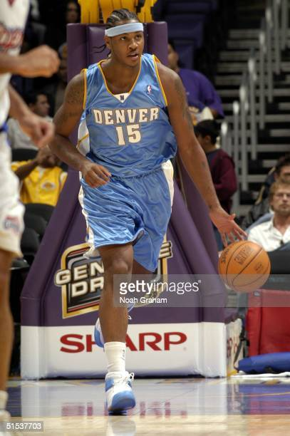 Carmelo Anthony of the Denver Nuggets brings the ball up the court against the Los Angeles Clippers at Staples Center on October 21 2004 in Los...