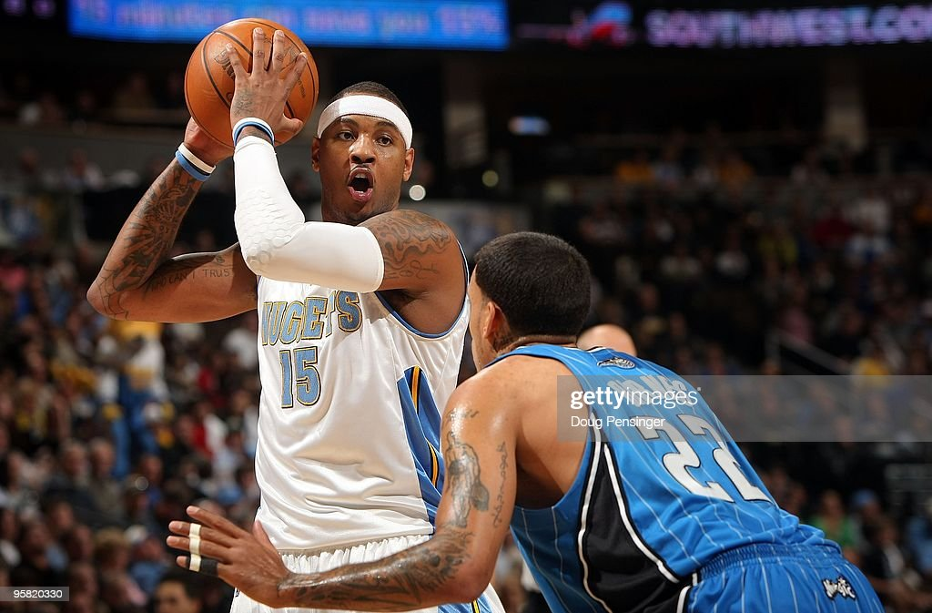Carmelo Anthony of the Denver Nuggets controls the ball against Matt Barnes of the Orlando Magic during NBA action at Pepsi Center on January 13 2010...