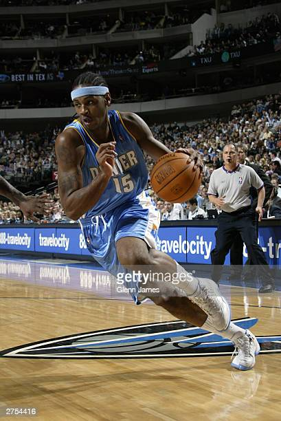 Carmelo Anthony of the Denver Nuggets drives against the Dallas Mavericks November 22 2003 at the American Airlines Center in Dallas Texas NOTE TO...