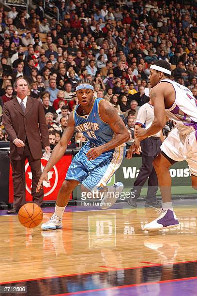 Carmelo Anthony of the Denver Nuggets drives baseline on Morris Peterson of the Toronto Raptors on November 9 2003 at the Air Canada Centre in...