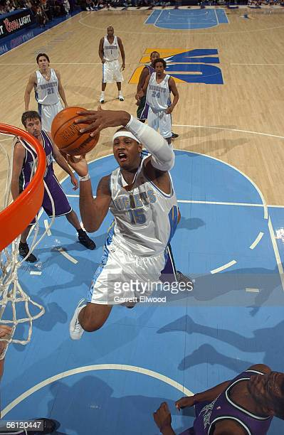 Carmelo Anthony of the Denver Nuggets drives for a shot attempt against the Milwaukee Bucks during a preseason game October 26 2005 at the Pepsi...