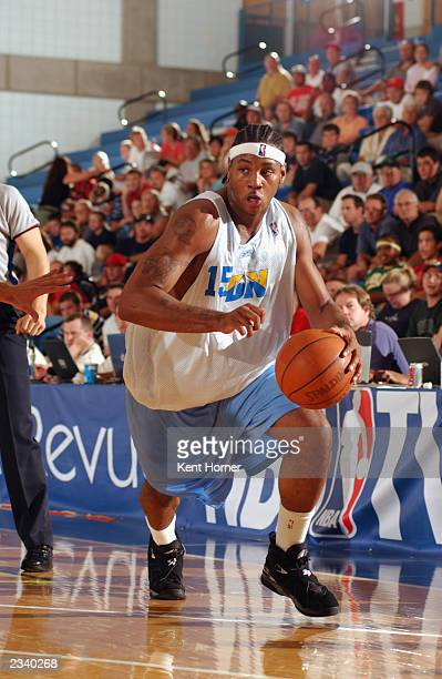 Carmelo Anthony of the Denver Nuggets drives to the basket during the Rocky Mountain Revue Summer league against the Indiana Pacers/Philadelphia...