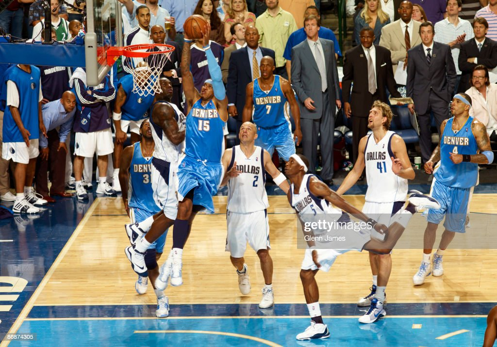 <a gi-track='captionPersonalityLinkClicked' href=/galleries/search?phrase=Carmelo+Anthony&family=editorial&specificpeople=201494 ng-click='$event.stopPropagation()'>Carmelo Anthony</a> #15 of the Denver Nuggets goes in for the dunk against Brandon Bass #32 of the Dallas Mavericks in Game Three of the Western Conference Semifinals during the 2009 NBA Playoffs at the American Airlines Center on May 9, 2009 in Dallas, Texas.