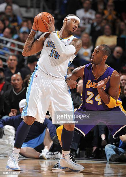 Carmelo Anthony of the Denver Nuggets goes to the basket against Kobe Bryant of the Los Angeles Lakers on January 21 2011 at the Pepsi Center in...