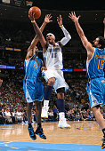 Carmelo Anthony of the Denver Nuggets goes to the basket against Rasual Butler of the New Orleans Hornets during Game Five of the Western Conference...