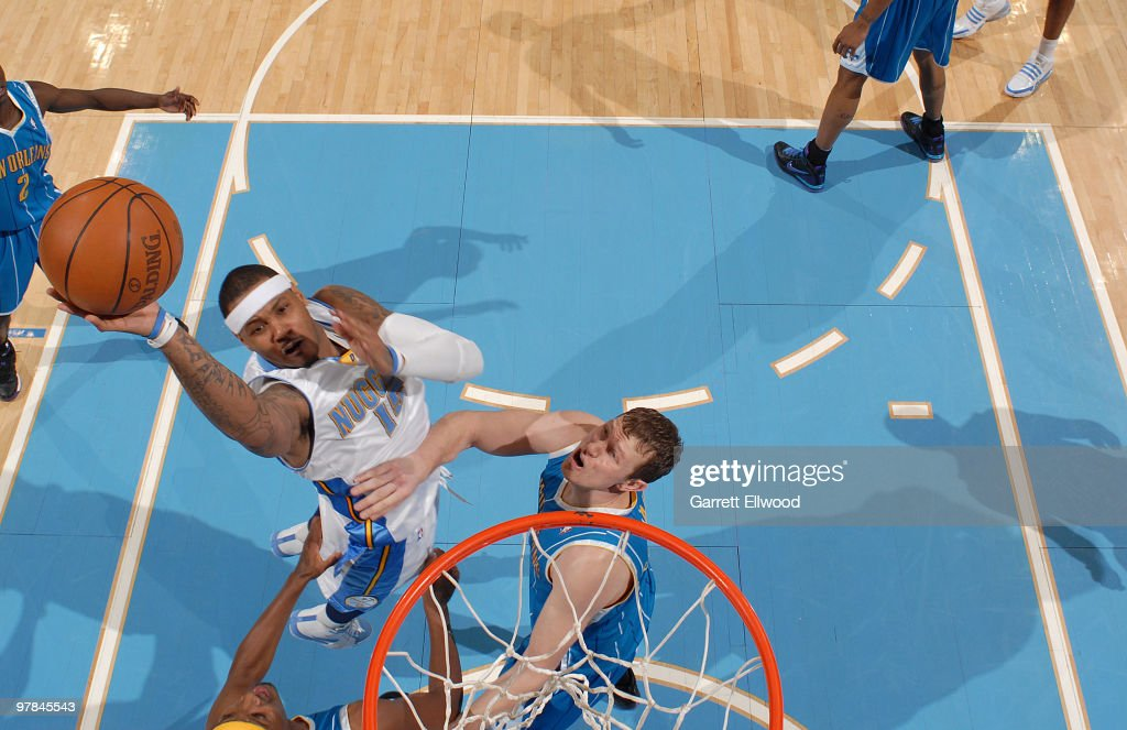 Carmelo Anthony #15 of the Denver Nuggets goes to the basket against the New Orleans Hornets on March 18, 2010 at the Pepsi Center in Denver, Colorado.