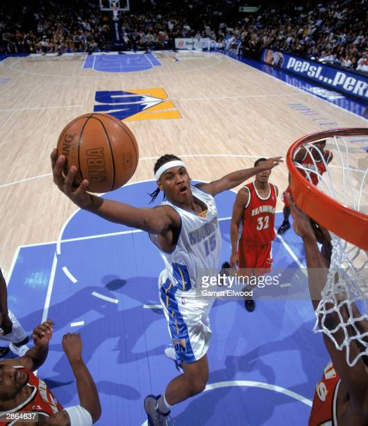 Carmelo Anthony of the Denver Nuggets goes to the basket during the NBA game against The Atlanta Hawks at Pepsi Center on January 3 2004 in Denver...