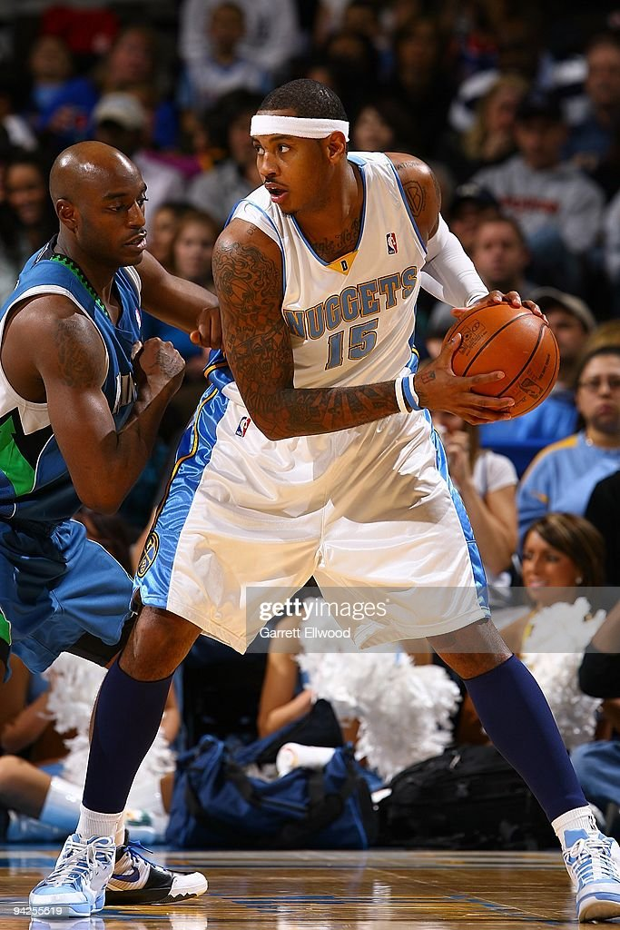 <a gi-track='captionPersonalityLinkClicked' href=/galleries/search?phrase=Carmelo+Anthony&family=editorial&specificpeople=201494 ng-click='$event.stopPropagation()'>Carmelo Anthony</a> #15 of the Denver Nuggets handles the ball against <a gi-track='captionPersonalityLinkClicked' href=/galleries/search?phrase=Damien+Wilkins&family=editorial&specificpeople=204651 ng-click='$event.stopPropagation()'>Damien Wilkins</a> #3 of the Minnesota Timberwolves during the game on November 29, 2009 at the Pepsi Center in Denver, Colorado. The Timberwolves won 106-100.