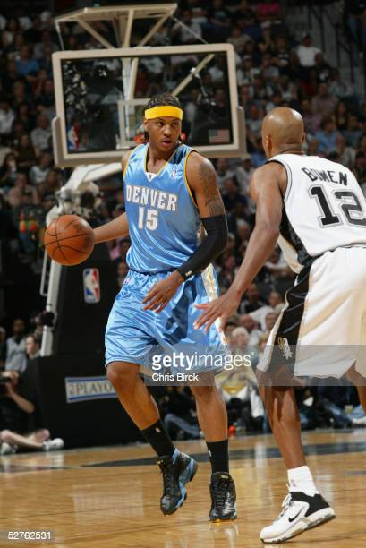 Carmelo Anthony of the Denver Nuggets is defended by Bruce Bowen of the San Antonio Spurs in Game two of the Western Conference Quarterfinals during...