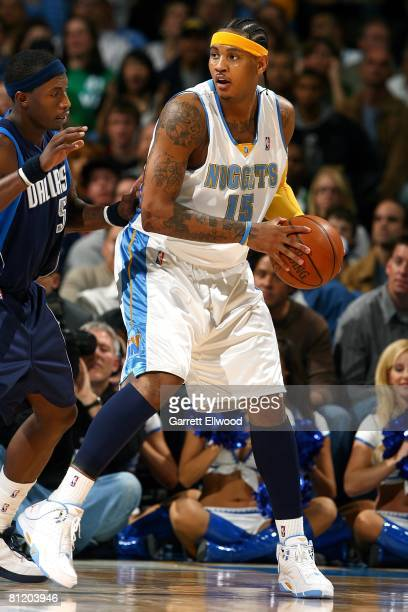 Carmelo Anthony of the Denver Nuggets looks to maneuver against Josh Howard of the Dallas Mavericks during the game on March 27 2008 at the Pepsi...
