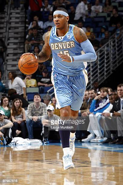 Carmelo Anthony of the Denver Nuggets moves the ball up court during the game against the New Orleans Hornets at New Orleans Arena on March 12 2010...