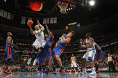 Carmelo Anthony of the Denver Nuggets puts up a shot over Amar'e Stoudemire and Danilo Gallinari of the New York Knicks at the Pepsi Center on...
