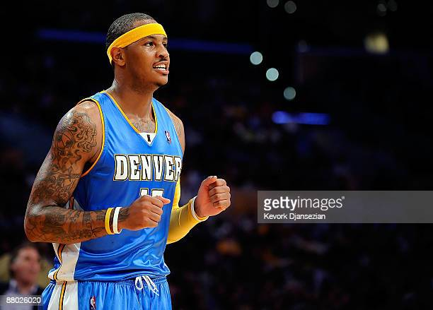Carmelo Anthony of the Denver Nuggets reacts in the third quarter against the Los Angeles Lakers in Game Five of the Western Conference Finals during...