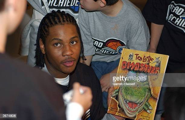 Carmelo Anthony of the Denver Nuggets reads to kids during a Denver Nuggets Read to Achieve event October 28 2003 at the Pepsi Center in Denver...