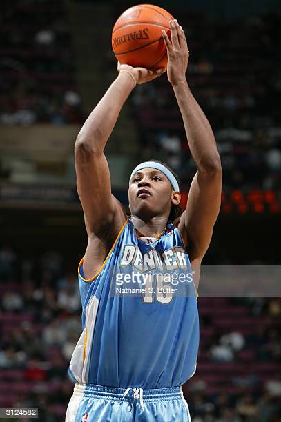 Carmelo Anthony of the Denver Nuggets shoots a free throw during the game against the New Jersey Nets on March 10 2004 at Continental Airlines Arena...