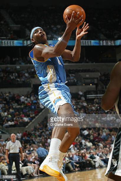 Carmelo Anthony of the Denver Nuggets shoots against the San Antonio Spurs during the game at the SBC Center in San Antonio Texas on April 14 2004...
