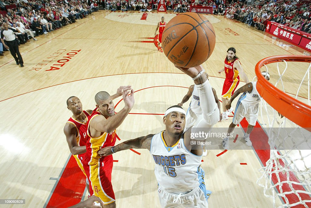 <a gi-track='captionPersonalityLinkClicked' href=/galleries/search?phrase=Carmelo+Anthony&family=editorial&specificpeople=201494 ng-click='$event.stopPropagation()'>Carmelo Anthony</a> #15 of the Denver Nuggets shoots the ball over <a gi-track='captionPersonalityLinkClicked' href=/galleries/search?phrase=Shane+Battier&family=editorial&specificpeople=201814 ng-click='$event.stopPropagation()'>Shane Battier</a> #31 of the Houston Rockets on February 14, 2011 at the Toyota Center in Houston, Texas.