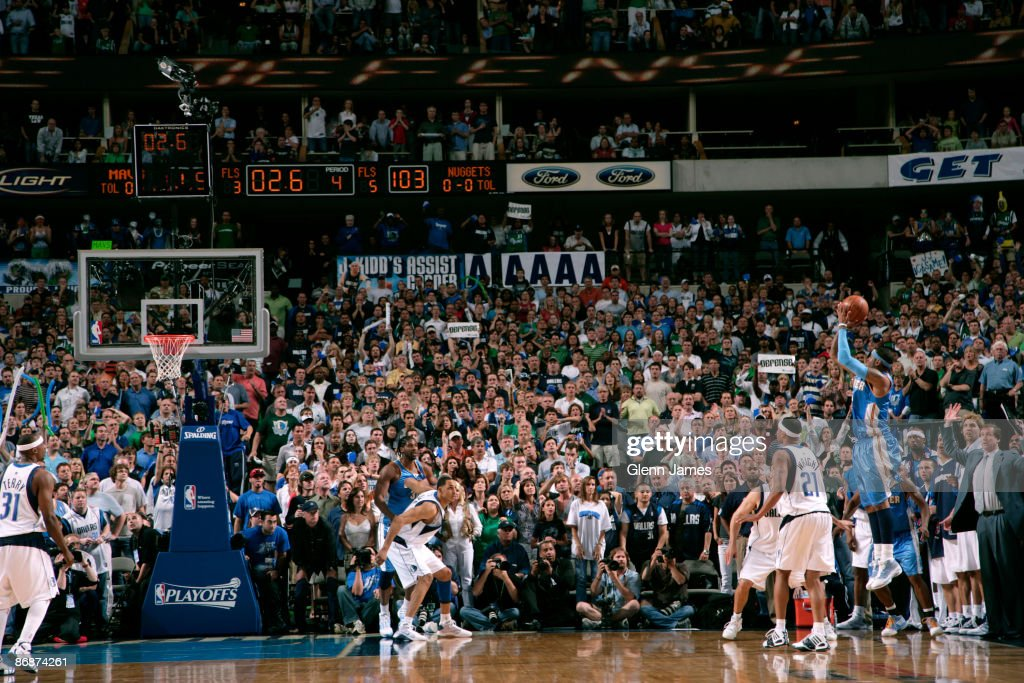 <a gi-track='captionPersonalityLinkClicked' href=/galleries/search?phrase=Carmelo+Anthony&family=editorial&specificpeople=201494 ng-click='$event.stopPropagation()'>Carmelo Anthony</a> #15 of the Denver Nuggets shoots what would be the game winning three against the Dallas Mavericks in Game Three of the Western Conference Semifinals during the 2009 NBA Playoffs at the American Airlines Center on May 9, 2009 in Dallas, Texas.