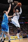 Carmelo Anthony of the Denver Nuggets takes a shot against Sean Marks of the New Orleans Hornets during Game Five of the Western Conference...