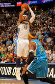 Carmelo Anthony of the Denver Nuggets takes a shot over James Posey of the New Orleans Hornets in Game Five of the Western Conference Quarterfinals...