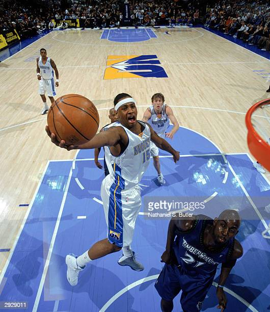 Carmelo Anthony of the Denver Nuggets takes the ball to the basket during the NBA game against the Minnesota Timberwolves at Pepsi Center on January...