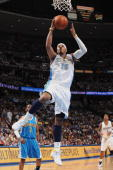Carmelo Anthony of the Denver Nuggets takes the ball to the basket against the New Orleans Hornets in Game Five of the Western Conference...