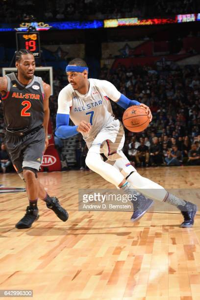 Carmelo Anthony of the Eastern Conference AllStar Team handles the ball against the Western Conference AllStar Team during the NBA AllStar Game as...