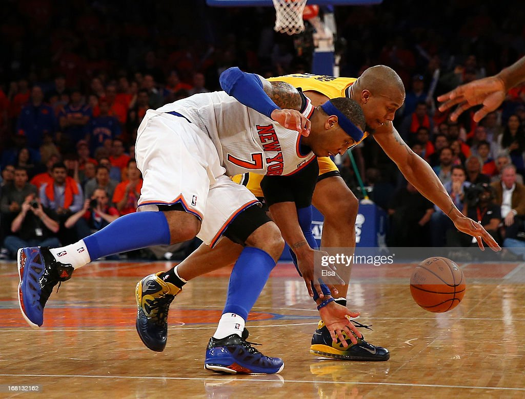 Carmelo Anthony #7 of the New York Knicks and David West #21 of the Indiana Pacers chase after the loose ball during Game One of the Eastern Conference Semifinals of the 2013 NBA Playoffs on May 5, 2013 at Madison Square Garden in New York City. The Indiana Pacers defeated the New York Knicks 102-95.