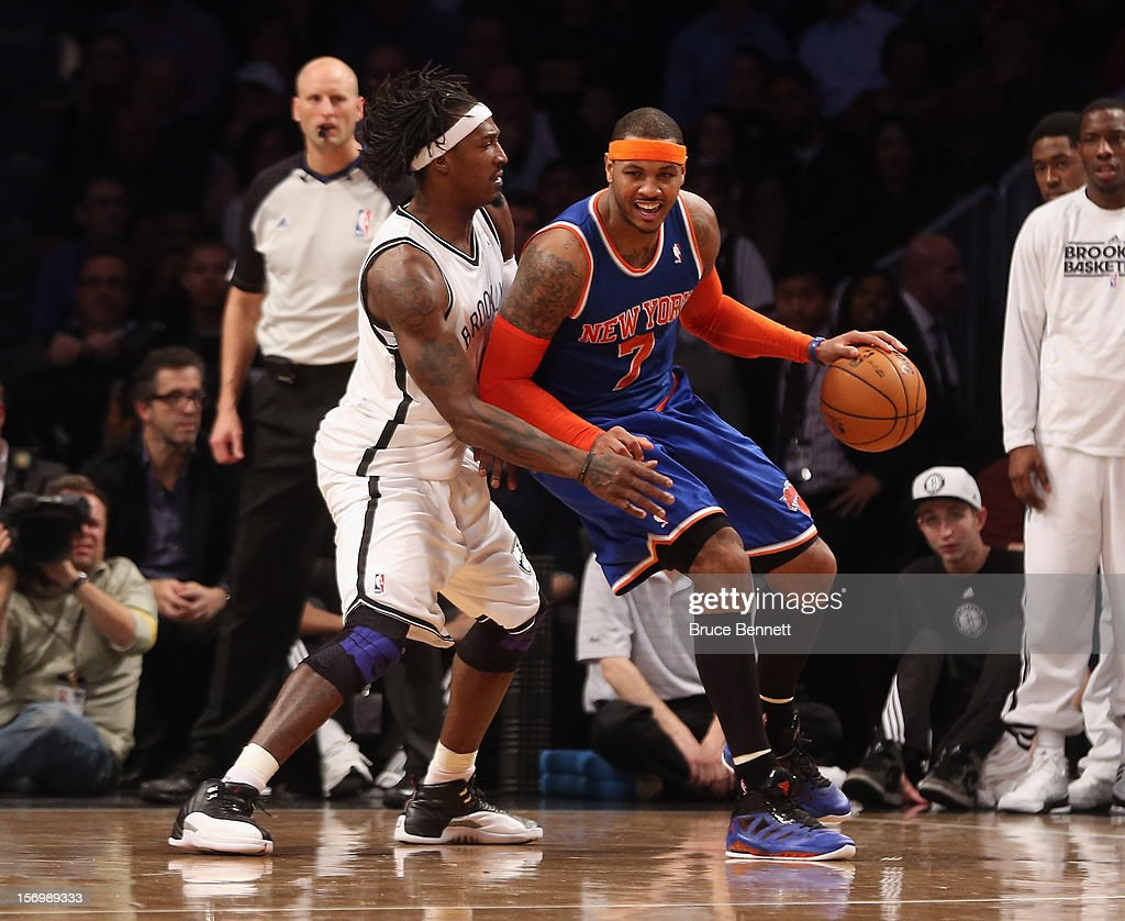 Carmelo Anthony #7 of the New York Knicks and Gerald Wallace #45 of the Brooklyn Nets battle for the ball at the Barclays Center on November 26, 2012 in the Brooklyn borough of New York City.