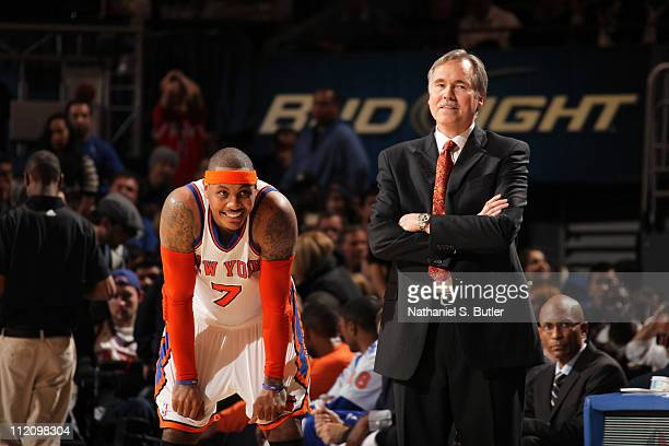 Carmelo Anthony of the New York Knicks and head coach Mike D'Antoni share a laugh during a break in the action against the Chicago Bulls on April 12...