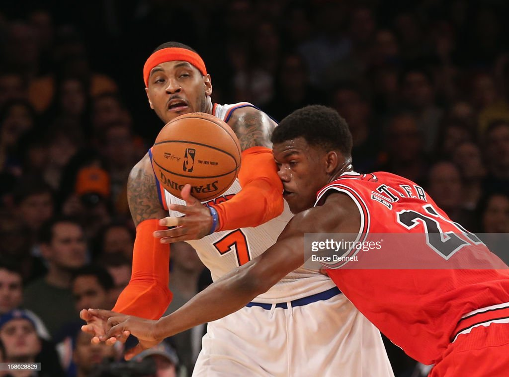 <a gi-track='captionPersonalityLinkClicked' href=/galleries/search?phrase=Carmelo+Anthony&family=editorial&specificpeople=201494 ng-click='$event.stopPropagation()'>Carmelo Anthony</a> #7 of the New York Knicks and <a gi-track='captionPersonalityLinkClicked' href=/galleries/search?phrase=Jimmy+Butler+-+Basketball+Player&family=editorial&specificpeople=9860567 ng-click='$event.stopPropagation()'>Jimmy Butler</a> #21 of the Chicago Bulls battle for the ball at Madison Square Garden on December 21, 2012 in New York City.