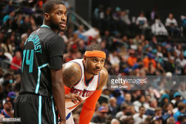 Carmelo Anthony of the New York Knicks and Michael KiddGilchrist of the Charlotte Hornets reacts to a play during the game on November 26 2016 at...