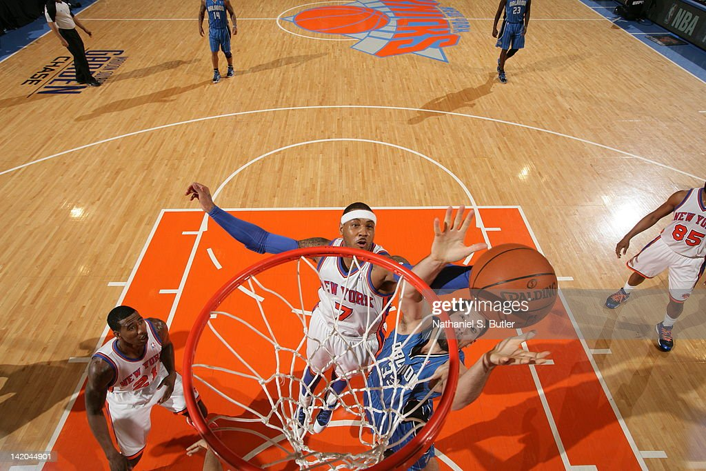 <a gi-track='captionPersonalityLinkClicked' href=/galleries/search?phrase=Carmelo+Anthony&family=editorial&specificpeople=201494 ng-click='$event.stopPropagation()'>Carmelo Anthony</a> #7 of the New York Knicks and Ryan Anderson #33 of the Orlando Magic reach for a rebound during the game on March 28, 2012 at Madison Square Garden in New York City.