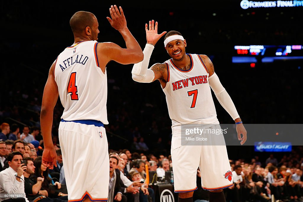 <a gi-track='captionPersonalityLinkClicked' href=/galleries/search?phrase=Carmelo+Anthony&family=editorial&specificpeople=201494 ng-click='$event.stopPropagation()'>Carmelo Anthony</a> #7 of the New York Knicks and teammate <a gi-track='captionPersonalityLinkClicked' href=/galleries/search?phrase=Arron+Afflalo&family=editorial&specificpeople=640861 ng-click='$event.stopPropagation()'>Arron Afflalo</a> #4 celebrate against the Minnesota Timberwolves at Madison Square Garden on December 16, 2015 in New York City.