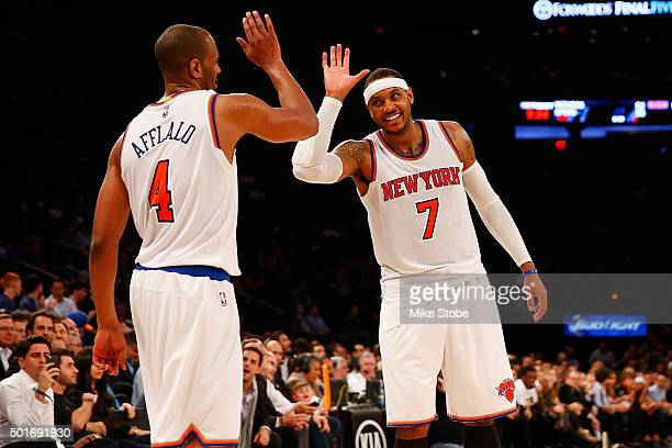 Carmelo Anthony of the New York Knicks and teammate Arron Afflalo celebrate against the Minnesota Timberwolves at Madison Square Garden on December...