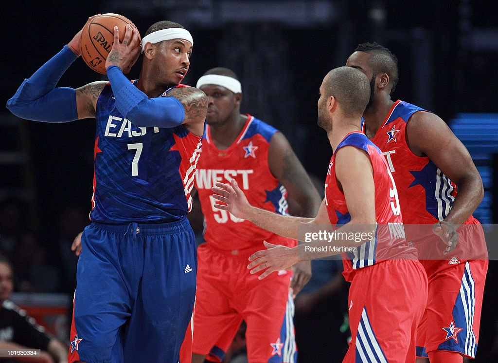 Carmelo Anthony #7 of the New York Knicks and the Eastern Conference is guarded by Zach Randolph #50, James Harden #13 and Tony Parker #9 of the Western Conference in the first quarter during the 2013 NBA All-Star game at the Toyota Center on February 17, 2013 in Houston, Texas.